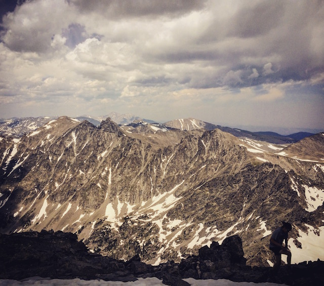 Kyle nearing the summit of N. Arapaho with Longs barely visible way to the north.