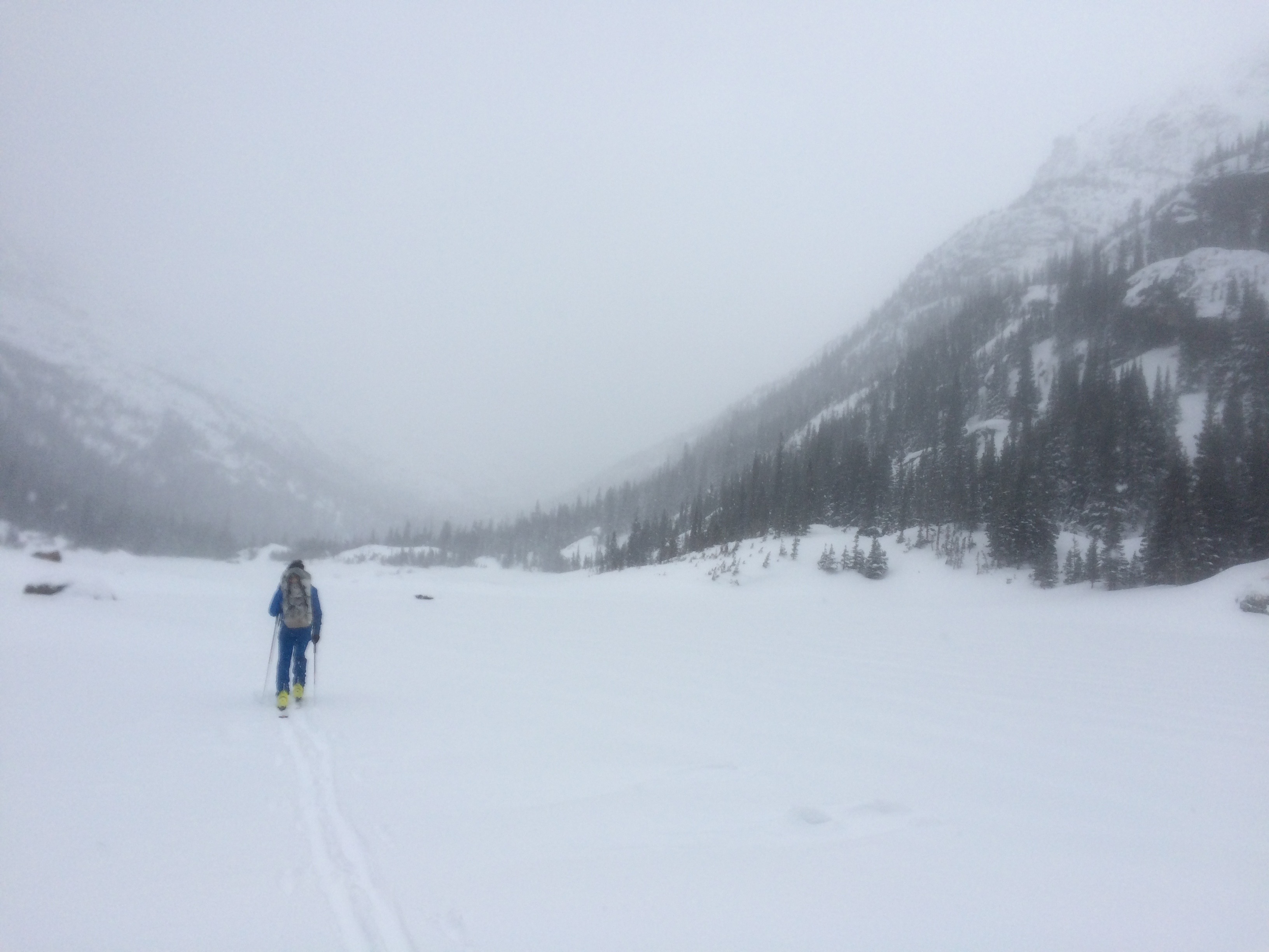 Blurry photo for a blurry day. Jed skinning across Mills Lake on the way to AMU (out of photo, upper right).